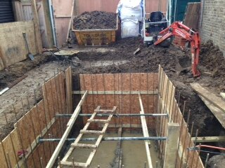 Sunken wine cellar dug to 2.5m depth and shuttered ready to receive reinforced concrete.